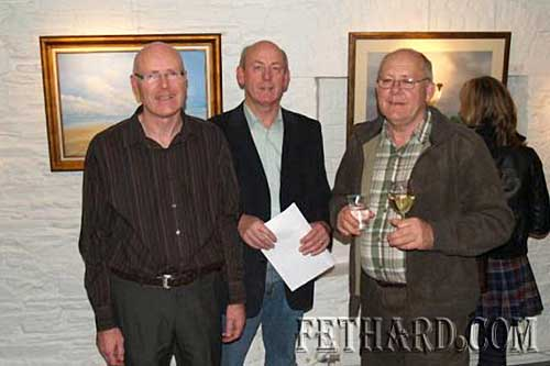 Joe Fogarty (left) photographed with his brothers John and Jim (right) at the Granary Gallery in Waterford