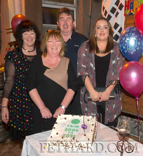 Cutting the cake at Butler's 10th Anniversary party are L to R: Marianne Shortall, Ann and Philip Butler and Ann Marie Butler.