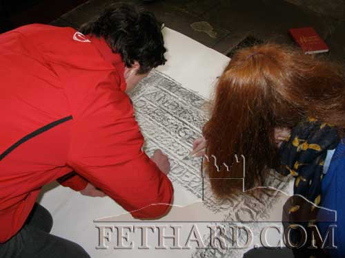 Students taking rubbings from the graveslabs in Holy Trinity Church of Ireland, Fethard.