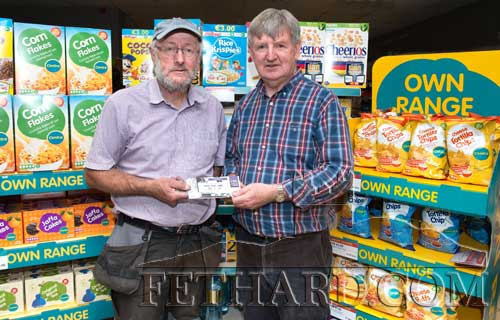 Ed Healy (left) winner of two All-Ireland Hurling Final tickets at the recent Centra fundraiser in aid of Fethard Hospice Support Group, receiving his prize from shop proprietor, Larry Kenny. Over €1,800 was raised overall.
