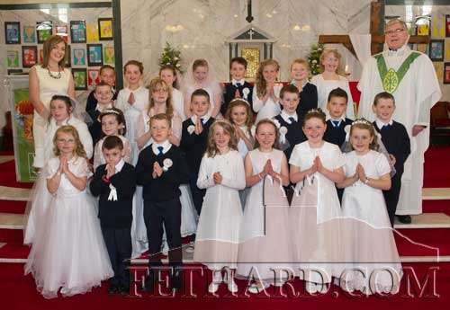 Boys and girls who received their First Holy Communion at Holy Trinity Parish Church. Included also is Canon Tom Breen P.P. and teacher Lisa Kearney.