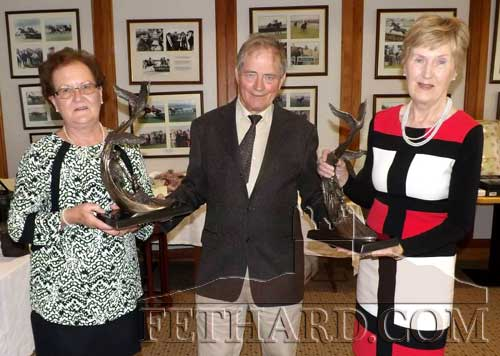 Club President, David O'Meara, presenting the President's Prize to winners Nora Ryan (left) and Gabrielle Schofield.