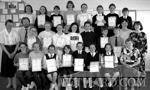 'My Home Place', a history project for schools organised by Fethard Historical Society, attracted a large number of excellent entries from the pupils of Fethard and Killusty primary schools. The project was designed to encourage pupils to ask and learn about their own families, home and environs. Pictured above are the Fethard pupils who were presented with certificates by Terry Cunningham, Chairman Fethard Historical Society. Back L to R: Eimear Gahan, Pamela Burke, Fiona Maher, Gillian O'Keeffe, Pamela Daly, Linda Corcoran, Aideen O'Donnell, Lena O'Connell. Middle L to R: Sr. Mary, Terry Cunningham, Mary Costello, Gillian O'Brien, Julianne Smith, Edwina McGrath, Donna Walsh, Noel Meaney and Shane Walsh (for Paddy Cooney), Maureen Maher (teacher) and Mary Hanrahan (teacher). Front L to R: Lisa O'Donnell, Elaine Williams, Marissa Roche, Nicola Lonergan, Noelle Leahy, Yvette Walsh, Patrice Tobin and Sr. Maureen, Principal Nano Nagle Primary School. (June 23, 1995).