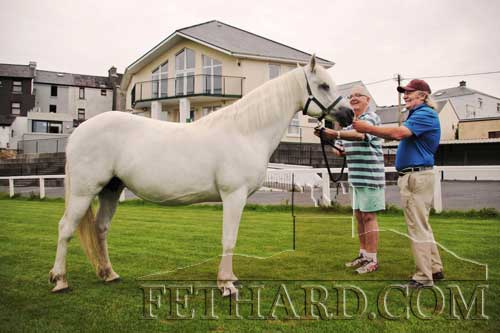 'Mouse' Morris (right) photographed with Noel Noonan of Manor Connemara Ponies along with 'Banks Vanilla', who won the Reserve Champion at the Connemara Pony Show 2015 in Clifden, Co. Galway.